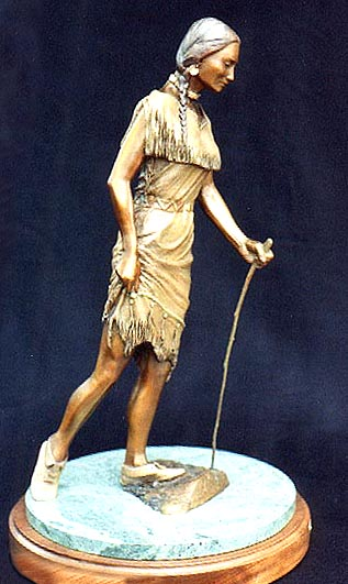 A Sioux maiden carefully crosses a stream at about the point in history of Europeans' first contact with them.  She wears a doeskin dress trimmed with quillwork and a precious steel  knife acquired from the white traders